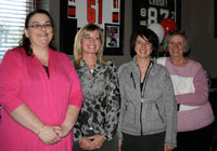 Royal LePage Lakes of Muskoka Booster Night organizing committee, from left to right: Michelle Cheeseman, Val Schrauwen, Sales Representative Wendy Webb and Broker Joan Ricard.
