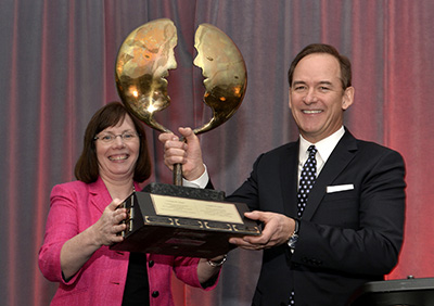 Maryjane Martin, APR, President of CPRS Toronto (left), presents the Toronto CEO Award of Excellence in Public Relations to Phil Soper, President and Chief Executive Officer, Royal LePage Real Estate Services, Wednesday, January 28, 2015, in Toronto. The award was created in 1991 to celebrate the Chief Executive Officer in the Greater Toronto area who best demonstrates personal excellence in the understanding and implementation of public relations practices. The Canadian Press Images PHOTO/CPRS Toronto