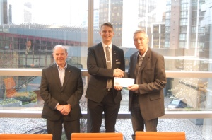 Accepting a cheque from Sheraton Vancouver Wall Centre general manager Sascha Voth (centre) is Marshall Cowe from Royal LePage West Real Estate Services in Coquitlam and Don Tebbutt from Royal LePage Wolstencroft in Langley.