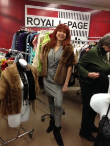 Pictured modeling a ladies cape is Heather Rothman, sales representative with Royal LePage Team Realty.