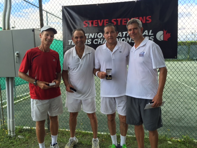 Fraser MacDonald, second from right, is pictured with tournament finalists Greg Bois (far left) and Patrice Resseau and his doubles teammate Bob Excell (far right) after winning the men's national over 55 doubles championship.