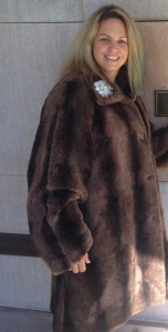 "Carol Rooney of Royal LePage Connect Realty in Ajax, Ontario came up with the winning bid for the ""Royal LePage Faux Fur Coat."""