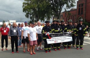 Local firefighters lead the second annual Walk a Mile in Her Shoes® in Fredericton, which was organized by Royal LePage Gardiner Realty.