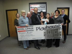 Warren Vandenameele, broker/owner of Royal LePage Premier Realty and team present $3,1900 in proceeds to LaVern Dumka of Shelwin House