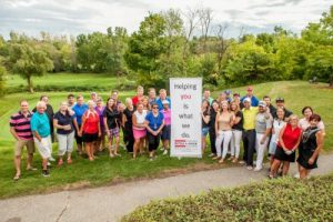 Attendees of the 7th annual Paula Mitchell golf tournament gather for a photo.