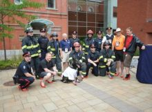 Members of the Fredericton, NB police and fire services prepare to 'Walk a Mile in Her Shoes'