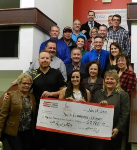 Royal LePage South Country Real Estate Services Annual Royal Gala committee members, agents and staff present a cheque to YWCA partnerships manager Kelly Mettler (bottom right).