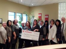 Royal LePage Performance Realty auction committee members accept a cheque from event sponsor, Scotiabank. Form L-R: Judy Mulligan, Saweena Seth, Kathy McVeigh, Anna Russell, Shelley Logue, Wendy Childs, Jutta Witteveen, Malissa Garcia, Lise Snelson, Gloria Bae and John Rogan.